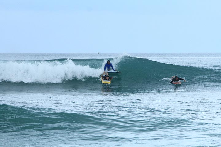 surfing class bigger green waves