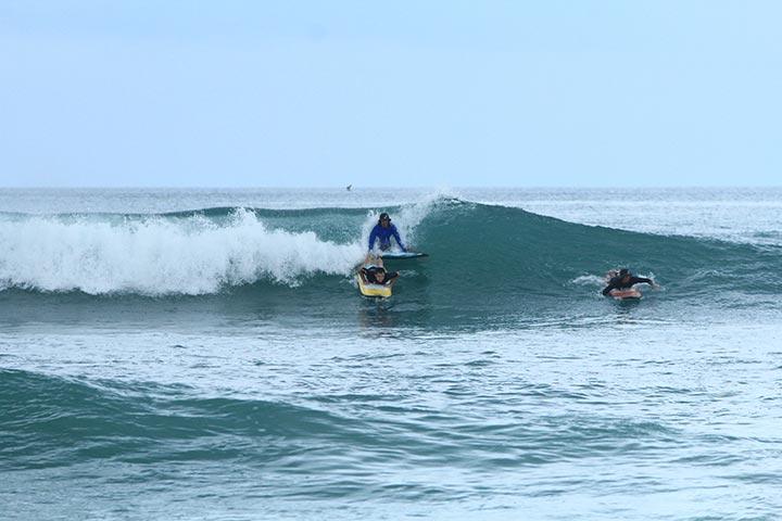 surfing class bigger green waves